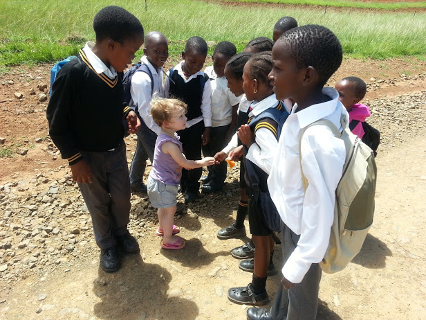 """""""She just loved it."""" Trixie greeting some school children from Maria Linden school, near Mamohau"""