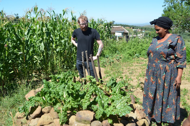Andy and Leticia Tshalana checking out a raised bed of spinach