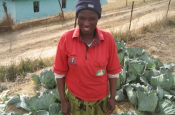 Nokulunga Mzobotshe surrounded by cabbages in one of her gardens